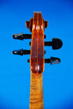 The fingerboard violin on a blue background Stock Photos