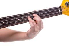 Fingeres en la guitarra baja Imagen de archivo libre de regalías