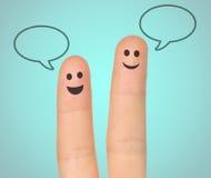 Fingeres felices con las burbujas del discurso Imagen de archivo