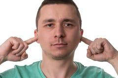 Fingeres hermosos de Guy Closing Ears With His fotos de archivo