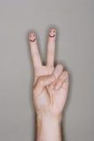 Fingerfolk som dras på den caucasian handen Arkivfoton