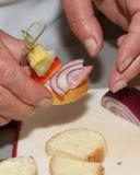 Fingerfood in der Schaffung Stockfotos