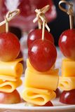 Fingerfood: grapes and cheese on skewers macro Royalty Free Stock Photo