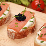 Fingerfood with smoked salmon. Fingerfood topped with smoked salmon and caviar stock photo