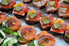 Fingerfood snacks. With salmon and salami Royalty Free Stock Image