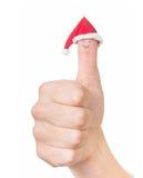 Fingerframsida i jultomtenhatt Begrepp för juldag Isolerat på Royaltyfria Bilder