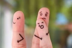 Fingerkonst av familjen under grälar Begreppet av barnet återstod med fadern, modern som lämnades att gå ut Royaltyfri Fotografi