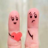 Fingerkonst av par begreppet är inte delad förälskelse Arkivfoton