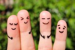 Fingerkonst av vänner begrepp av att skratta för folk royaltyfri fotografi