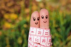 Fingerkunst eines glücklichen Paars mit Meter Stockbild