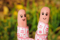 Fingerkunst eines glücklichen Paars mit Meter Stockbilder