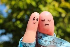 Fingerkunst von Paaren mit Meter Stockbild