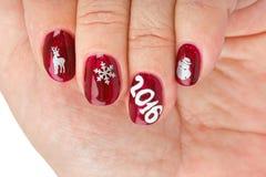 Fingernagel mit Weihnachtsmuster Lizenzfreie Stockbilder