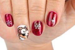 Fingernagel mit Weihnachtsmuster Stockbilder