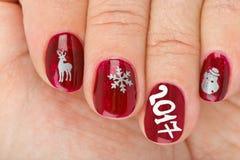 Fingernagel mit Weihnachtsmuster Lizenzfreies Stockbild