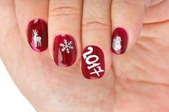 Fingernagel mit Weihnachtsmuster Stockfoto