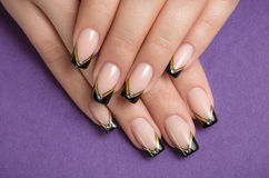 Fingernails with black french manicure Stock Image