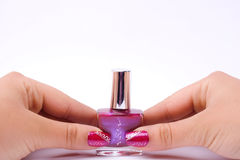 Fingernail cosmetic. Woman hand with beautiful colored fingernails. Cosmetic and manicure Royalty Free Stock Image