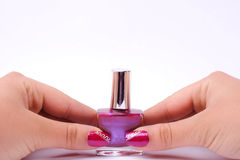 Fingernail cosmetic. Woman hand with beautiful colored fingernails. Cosmetic and manicure Royalty Free Stock Photography