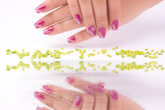 Fingernail cosmetic. Woman hand with beautiful colored fingernails. Cosmetic and manicure Stock Images