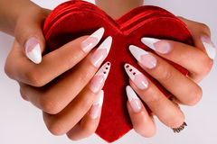 Fingernail cosmetic. Woman hand with beautiful colored fingernails. Cosmetic and manicure Stock Photos