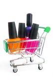 Fingernail enamel in shopping trolley Stock Photos