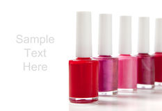 Fingernail polish on white with copy space Royalty Free Stock Image