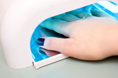 Fingernail polishing machine Stock Photos