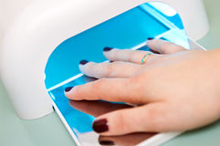 Fingernail polishing machine Royalty Free Stock Photos