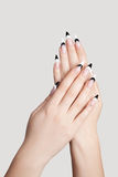 Fingernails. Two hands with beautiful nails sharp shape on graybackground royalty free stock photography