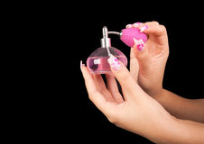 Fingernails and parfum Stock Photo