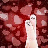 Fingerpaare auf rotem Hintergrund Stockfotografie