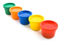 Fingerpaint. Colorful fingerpaint pots in a row isolated over white stock photography