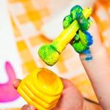 Fingerpaint. Child holding finger paint brush close-up royalty free stock photo