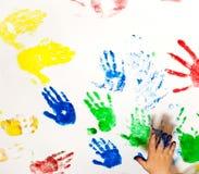 Fingerpaint. White paper with child handprints stock photos