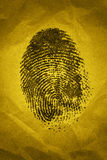 Fingerprint. A fingerprint on a textured background with dramatic lighting Royalty Free Stock Image