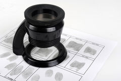Fingerprint card. And magnifying glass Royalty Free Stock Images