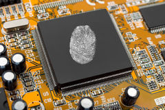 Fingerprint on computer chip royalty free stock image