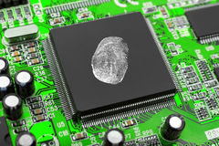 Fingerprint on computer chip Stock Photo