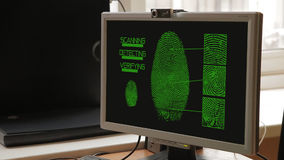 Fingerprint Scan Biometrics Identify Authorization Concept v1. Scanned fingerprints showing on the monitor's screen. Scanning, searching and verifying stock video footage