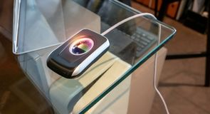 Fingerprint scanner on glass table for check-in security system stock photos