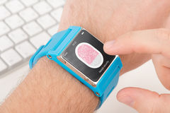 Fingerprint scanning on smartwatch Stock Photo