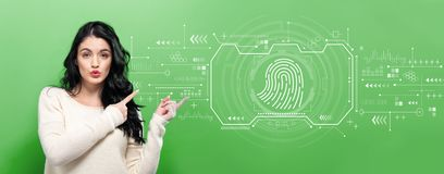 Fingerprint scanning theme with young woman royalty free stock photos