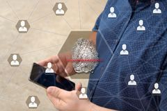 Fingerprint scanning on the touch screen with a blur background of the businessman with the phone.The concept of Secure access thr royalty free stock images