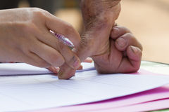 Fingerprinting. Hand of old man  fingerprinting on paper with ink Royalty Free Stock Image