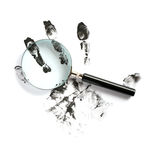 Fingerprints And Magnifying Glass Royalty Free Stock Images