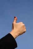 Fingers. Thumb; hand; good; ok; nail; red; sky; blue Royalty Free Stock Photos