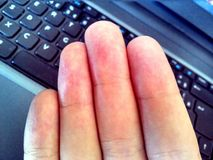 Fingers above the notebook keyboard Royalty Free Stock Photo