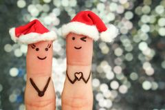 Fingers art of couple celebrates Christmas. royalty free stock image