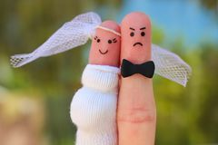 Fingers art of couple. Concept of shotgun wedding. Man was upset because woman is pregnant Stock Image